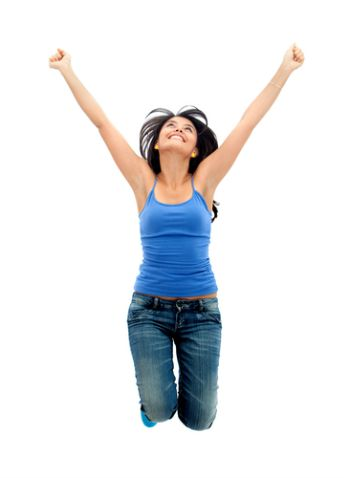 Happy woman jumping with arms up - isolated over white