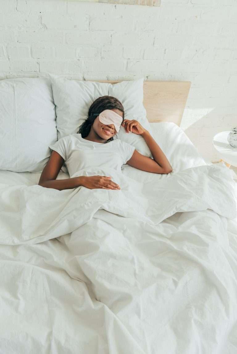 African american girl sleeping with a sleep mask